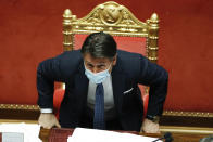 Italian Prime Minister Giuseppe Conte sits after his final address at the Senate prior to a confidence vote, in Rome, Tuesday, Jan. 19, 2021. Italian Premier Giuseppe Conte fights for his political life with an address aimed at shoring up support for his government, which has come under fire from former Premier Matteo Renzi's tiny but key Italia Viva (Italy Alive) party over plans to relaunch the pandemic-ravaged economy. (Yara Nardi/pool photo via AP)