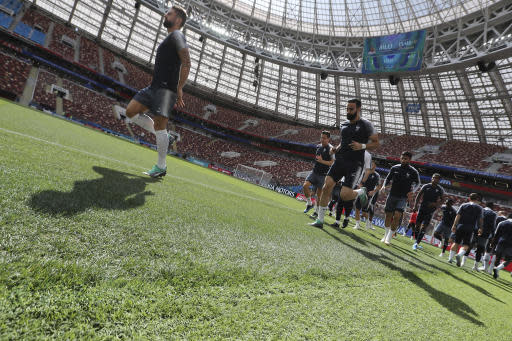 France's Olivier Giroud and Adil Rami warm up during France's official training at the eve of the group C match between France and Denmark at the 2018 soccer World Cup in the Luzhniki Stadium in Moscow, Russia, Monday, June 25, 2018. (AP Photo/David Vincent)