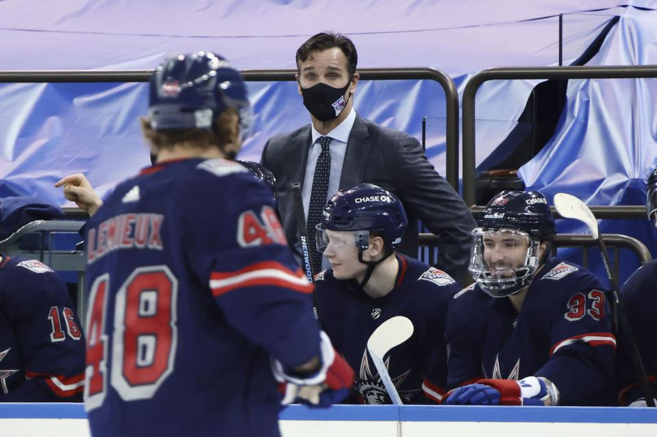 New York Rangers coach David Quinn of the New York Rangers stands behind the bench during the team's NHL hockey game against the Washington Capitals on Thursday, Feb. 4, 2021, in New York. (Bruce Bennett/Pool Photo via AP)