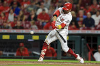 Cincinnati Reds' Joey Votto hits a two-run home run during the third inning of a baseball game against the Pittsburgh Pirates in Cincinnati, Monday, Sept. 20, 2021. (AP Photo/Aaron Doster)