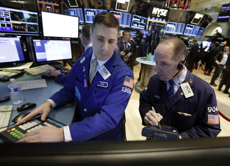 Specialist Joseph Mastrolia, left, and trader Michael Urkonis work on the floor of the New York Stock Exchange, Tuesday, March 25, 2014. Stocks are opening higher on Wall Street as the market shrugs off a two-day decline. (AP Photo/Richard Drew)