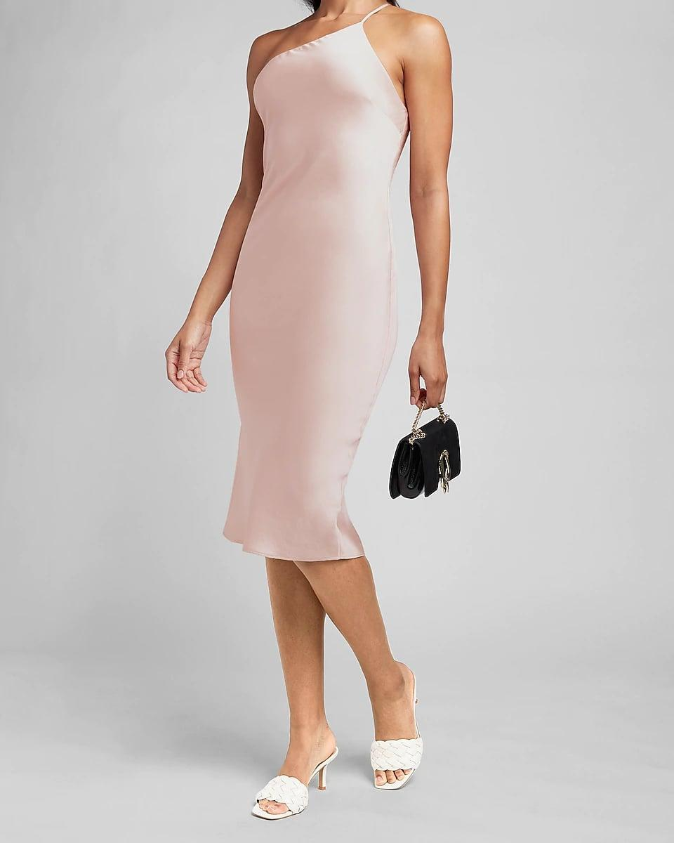 <p>From the light shade to the one-shoulder silhouette, everything about this <span>Express Satin Cross Back One Shoulder Slip Dress</span> ($98) exudes femininity and confidence. It makes for a modern ensemble you can wear to the office (on a particularly fashionable day) and beyond.</p>