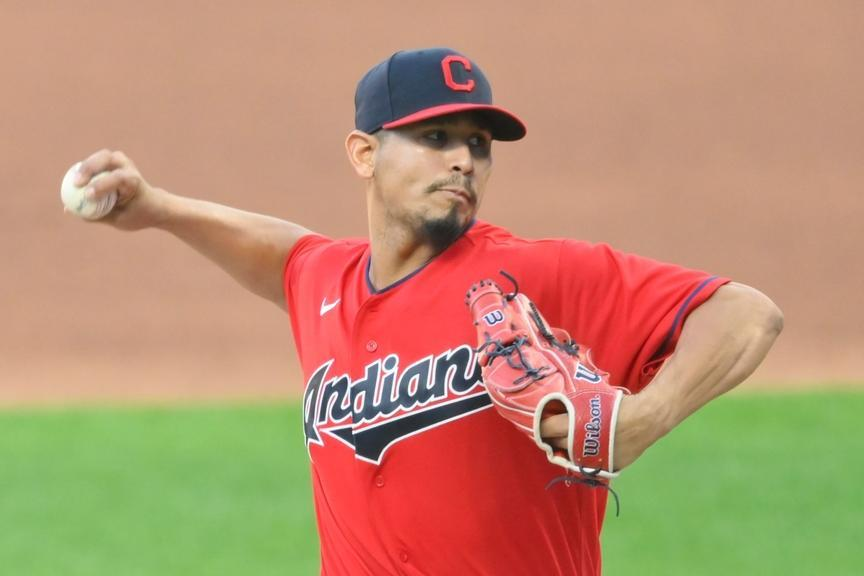 Carlos Carrasco on the mound in a red Indians jersey