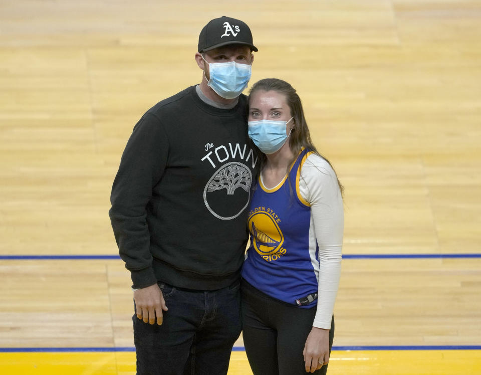 Shelby Delaney, right, an intensive care unit nurse at Oakland's Alta Bates Summit Medical Center and her husband