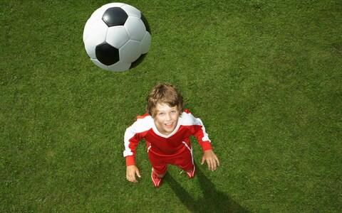 A child prepares to head the ball - Credit: Tim Macpherson