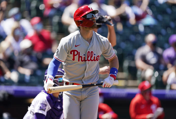 Philadelphia Phillies' Bryce Harper heads up the first base line after hitting a solo home run off Colorado Rockies starting pitcher Jon Gray in the first inning of a baseball game Sunday, April 25, 2021, in Denver. (AP Photo/David Zalubowski)