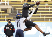 Iowa State wide receiver Sean Shaw, right, leaps for a catch as West Virginia cornerback Nicktroy Fortune, left, tries to defend during the first half of an NCAA college football game, Saturday, Dec. 5, 2020, in Ames, Iowa. (AP Photo/Matthew Putney)