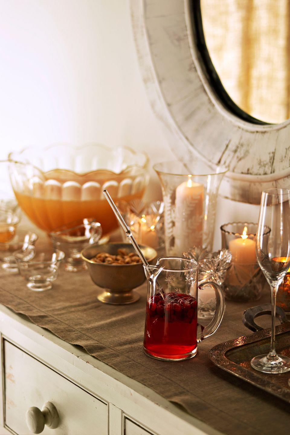 """<p>Heat apple cider, cinnamon, nutmeg, and ginger in a stockpot, then add bourbon to create a spiked tipple.</p><p><strong><a href=""""https://www.countryliving.com/food-drinks/recipes/a3290/warm-bourbon-cider-recipe/"""" rel=""""nofollow noopener"""" target=""""_blank"""" data-ylk=""""slk:Get the recipe"""" class=""""link rapid-noclick-resp"""">Get the recipe</a>.</strong> </p>"""