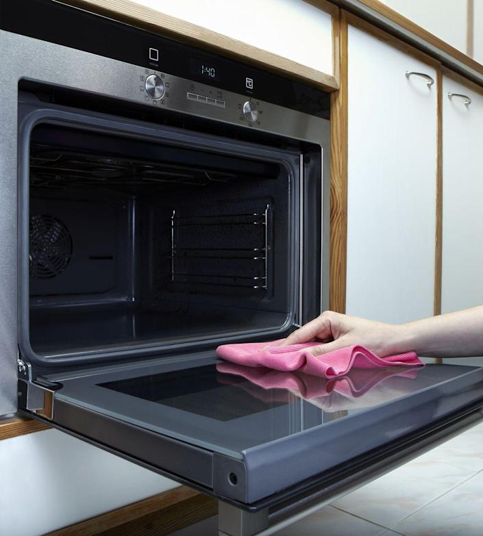 """<p>Tackling the spills and splatters in your oven doesn't have to be a daunting task. As <a href=""""https://melissapoepping.com/"""" rel=""""nofollow noopener"""" target=""""_blank"""" data-ylk=""""slk:Melissa Poepping"""" class=""""link rapid-noclick-resp"""">Melissa Poepping</a>, natural cleaning expert and author of the <em>Chemical Free Home, </em>told <em>Martha Stewart</em>, <a href=""""https://www.marthastewart.com/1062857/how-clean-oven"""" rel=""""nofollow noopener"""" target=""""_blank"""" data-ylk=""""slk:all you need is some baking soda and vinegar"""" class=""""link rapid-noclick-resp"""">all you need is some baking soda and vinegar</a>, and she recommends tackling your oven with these two ingredients every few weeks. <br></p><p>To start, remove your oven racks and let them sit in dishwashing liquid for a few hours before scrubbing with a scouring pad. After removing your racks, create a paste using three quarter cups baking soda and one quarter cup warm water. Then, use a paintbrush to spread the paste throughout the oven's interior, avoiding bare metal surfaces and the oven door. Let it sit overnight and then remove the paste the following day with a plastic scraper, wetting as needed. </p>"""