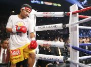 Manny Pacquiao of the Philippines arrives in the ring to face Floyd Mayweather Jr. of the U.S. ahead of their welterweight WBO, WBC and WBA (Super) title fight in Las Vegas, Nevada, May 2, 2015. REUTERS/Steve Marcus