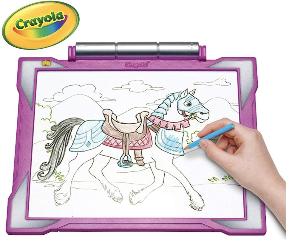 """<p>They can take this <a href=""""https://www.popsugar.com/buy/Crayola-Light-up-Tracing-Pad-493083?p_name=Crayola%20Light-up%20Tracing%20Pad&retailer=amazon.com&pid=493083&price=25&evar1=moms%3Aus&evar9=25997679&evar98=https%3A%2F%2Fwww.popsugar.com%2Fphoto-gallery%2F25997679%2Fimage%2F46685334%2FCrayola-Light-up-Tracing-Pad&list1=holiday%2Cgift%20guide%2Ckid%20shopping%2Choliday%20living%2Choliday%20for%20kids&prop13=api&pdata=1"""" class=""""link rapid-noclick-resp"""" rel=""""nofollow noopener"""" target=""""_blank"""" data-ylk=""""slk:Crayola Light-up Tracing Pad"""">Crayola Light-up Tracing Pad</a> ($25) everywhere and create their own art.</p>"""