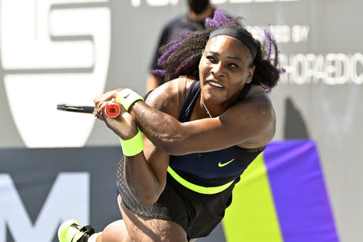 Serena Williams returns a shot to Shelby Rogers during action in their WTA tennis tournament match in Nicholasville, Ky., Friday, Aug. 14, 2020. (AP Photo/Timothy D. Easley)