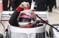 FILE - In this Feb. 12, 2020, file photo, IndyCar driver Will Power lowers into his car as he prepares to drive in IndyCar Series testing, in Austin, Texas. The 2020 IndyCar season will open Saturday night, June 6, at Texas Motor Speedway. An already lengthy offseason has been stretched to more than eight months since IndyCar last raced and the first event back is at Texas' high-speed oval where drivers will get their first test of a heavy new windshield designed to protect the cockpit. (AP Photo/Eric Gay, File)
