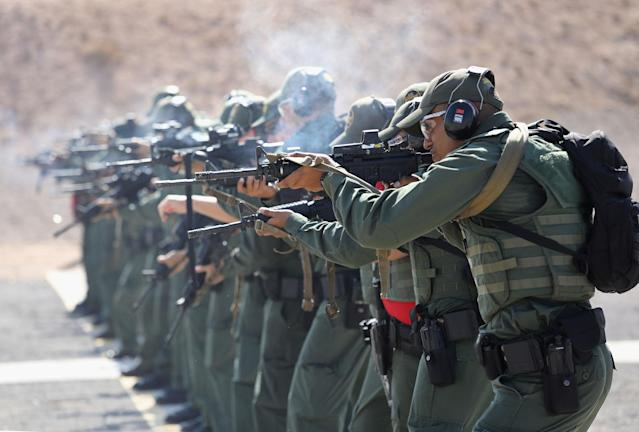 <p>U.S. Border Patrol trainees fire M-4 rifles during a weapons training class at the U.S. Border Patrol Academy on August 3, 2017 in Artesia, N.M. (Photo: John Moore/Getty Images) </p>
