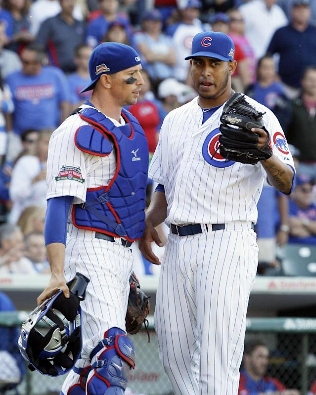 Chicago Cubs relief pitcher Hector Rondon, right, talks with catcher John Baker during the ninth inning of a baseball game against the Miami Marlins in Chicago, Friday, June 6, 2014. (AP Photo/Nam Y. Huh)