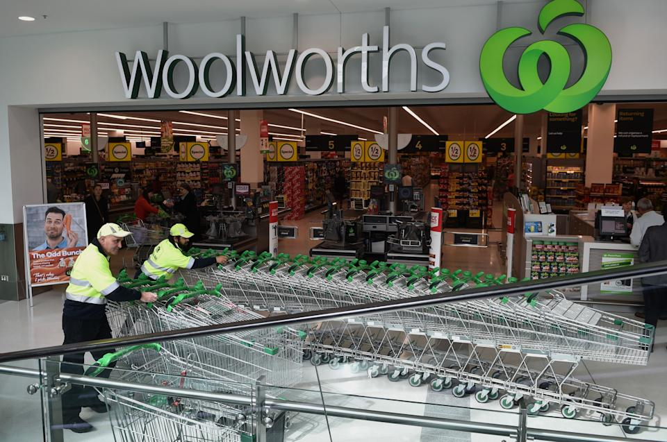 Workers push shopping trolleys at a Woolworths store in Sydney. Source: Getty Images