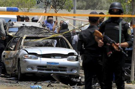 Policemen secure the site of a car bomb attack on the convoy of Egyptian public prosecutor Hisham Barakat near his house at Heliopolis district in Cairo, June 29, 2015. REUTERS/Mohamed Abd El Ghany