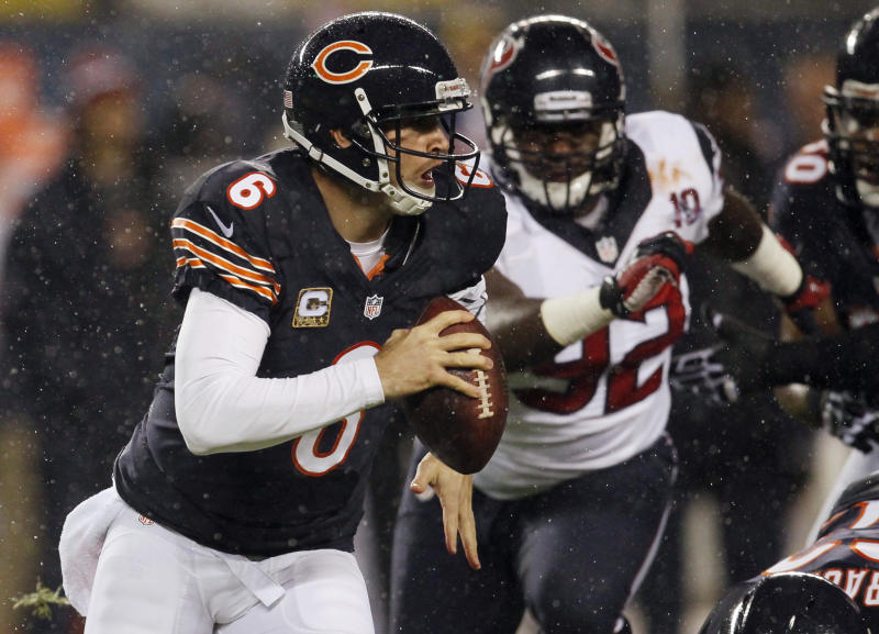 Chicago Bears quarterback Jay Cutler (6) scrambles away from Houston Texans defensive tackle Earl Mitchell (92) during the first half an NFL football game, Sunday, Nov. 11, 2012, in Chicago. (AP Photo/Charles Rex Arbogast)