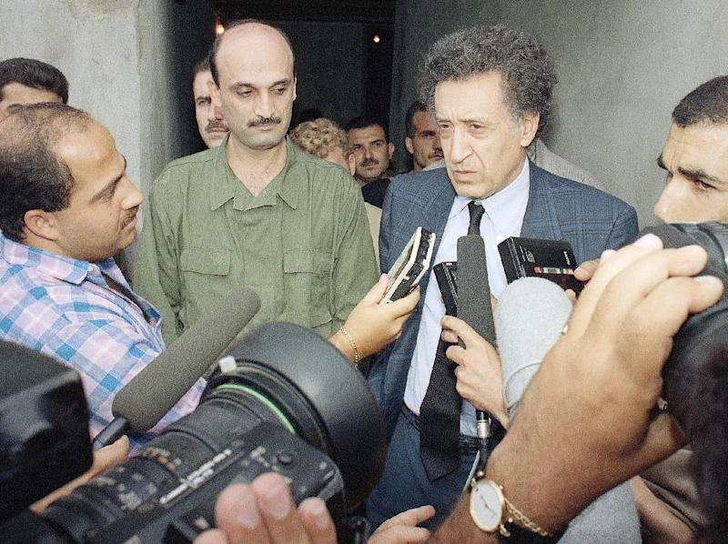FILE - This is a Tuesday, July 17, 1990 file photo of Arab League Mediator Lakhdar Brahimi, right, as he talks to the media after his 90-minute meeting with Christian Lebanese forces militia Chieftain Samiar Geagea, left. Lakhdar Brahimi has seen faces like these before, barely able to remain in the same room, much less speak to each other. Lebanese, Afghans, Iraqis, now Syrians. Even, two decades ago, Algerians like himself. For days now, the veteran U.N. mediator has presided over peace talks intended to lead the way out of Syria's civil war. He brought President Bashar Assad's government and the opposition face to face for the first time on Saturday, Jan. 25, 2014, while still ensuring that they don't have to enter by the same door or address each other directly. He is 80. He is patient. (AP Photo/Eddy Tamerian, File)