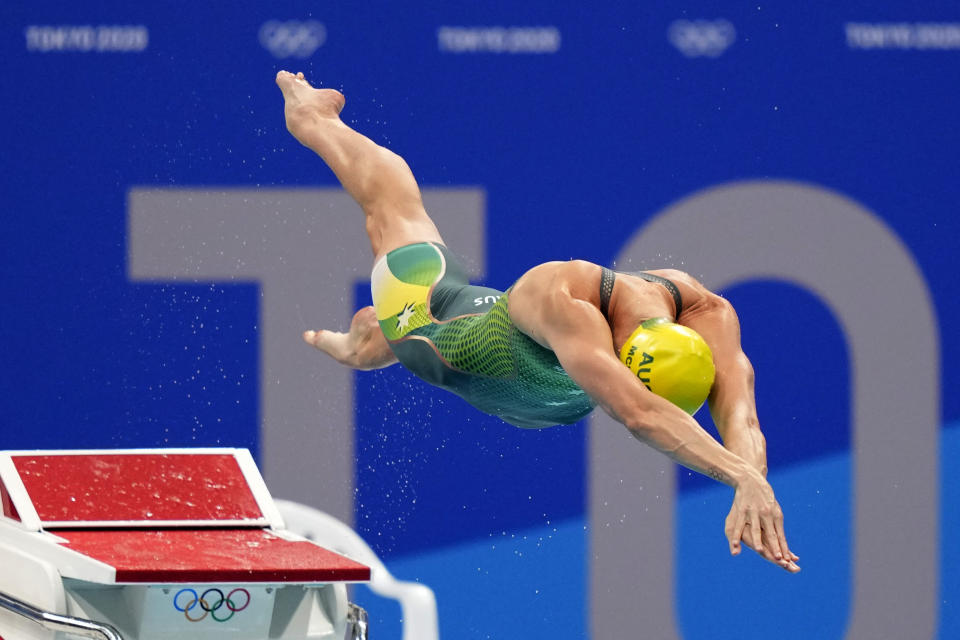 Emma Mckeon, of Australia, dives off the starting block in the women's 50-meter freestyle final at the 2020 Summer Olympics, Sunday, Aug. 1, 2021, in Tokyo, Japan. (AP Photo/David Goldman)