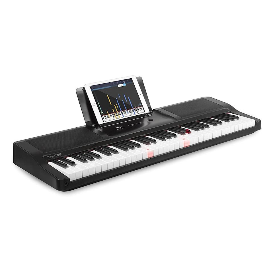 "If your dad is all about trying new things, this top-rated smart keyboard has ""quarantine activity"" written all over it. Score this bad boy on Amazon with your Prime account. $299, Amazon. <a href=""https://www.amazon.com/ONE-Keyboard-Electric-Music-Teaching/dp/B016DOY9UI/ref=sr_1_5?dchild=1&keywords=one+keyboard+piano&qid=1591717547&sr=8-5"" rel=""nofollow noopener"" target=""_blank"" data-ylk=""slk:Get it now!"" class=""link rapid-noclick-resp"">Get it now!</a>"