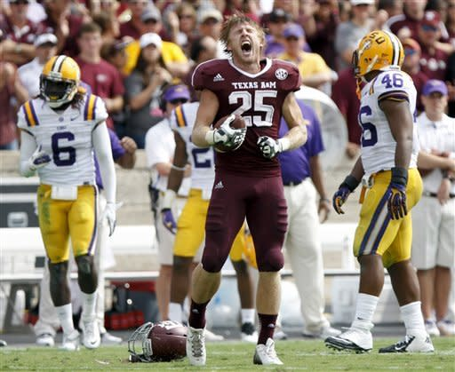 Texas A&M wide receiver Ryan Swope (25) screams after making a completion against LSU during the first half of their NCAA college football game, Saturday, Oct. 20, 2012, in College Station, Texas. (AP Photo/Eric Kayne)