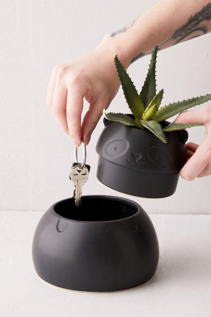 """<h2>Urban Outfitters Hideaway Panda Storage Planter</h2><br>The true definition of function and style! Although some do not subscribe to the hideaway key lifestyle, this panda pot could still be used for something like leaving notes — or, simply for housing your best plant pal. It is a win-win no matter what you choose. <br><br><em>Shop <strong><a href=""""http://urbanoutfitters.com"""" rel=""""nofollow noopener"""" target=""""_blank"""" data-ylk=""""slk:Urban Outfitters"""" class=""""link rapid-noclick-resp"""">Urban Outfitters</a></strong></em><br><br><strong>Urban Outfitters</strong> Panda Storage Planter, $, available at <a href=""""https://go.skimresources.com/?id=30283X879131&url=https%3A%2F%2Fwww.urbanoutfitters.com%2Fshop%2Fhideaway-panda-storage-planter"""" rel=""""nofollow noopener"""" target=""""_blank"""" data-ylk=""""slk:Urban Outfitters"""" class=""""link rapid-noclick-resp"""">Urban Outfitters</a>"""