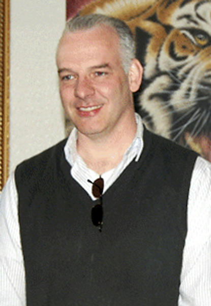 FILE - In this April 12, 2011 file photo, Neil Heywood, a British business consultant, smiles at an art gallery in Beijing. His body was found in a secluded Chongqing hotel in November 2011. Gu Kailai, wife of disgraced politician Bo Xilai, went on trial on a charge of murder of Heywood Thursday, Aug. 9, 2012 at the Hefei Intermediate People's Court in eastern China. (AP Photo/China.org.cn, File) CHINA OUT