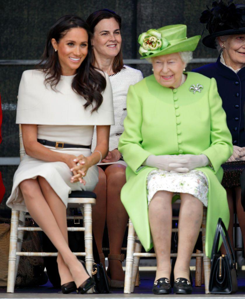 <p>Queen Elizabeth is a firm believer that ladies should keep their heads covered (which is why she often wears a scarf or a crown when she's not in a hat), so it was particularly bold when Meghan went hat-less to an event where she was seated right next to the Queen. </p>