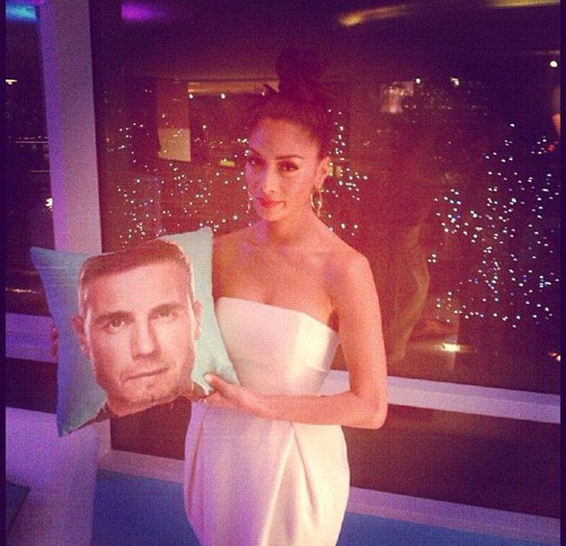 Celebrity Twitpics: Nicole Scherzinger showed off her teasing side this week by posting a picture of herself with a cushion featuring Gary Barlow's face. We like her unimpressed expression. [Copyright: Nicole Scherzinger]