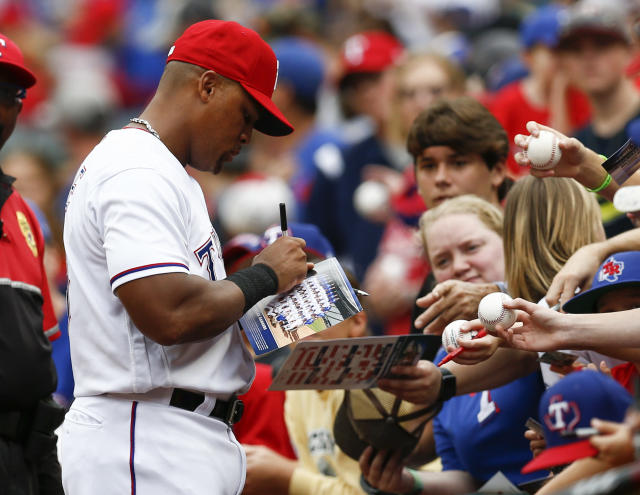 Texas Rangers' Adrian Beltre gives autographs to fans before his team's baseball game against the Seattle Mariners, Sunday, Sept. 23, 2018, in Arlington, Texas. (AP Photo/Jim Cowsert)