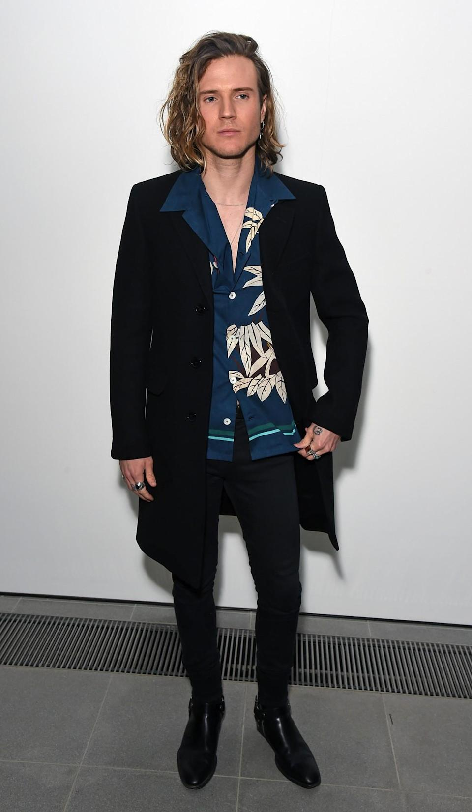 <p>Dougie Poynter opted for his usual printed shirt look. <i>[Photo: Getty]</i> </p>