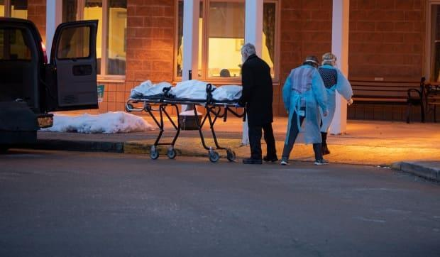 The body of a deceased resident of an Ontario long-term care home is taken away in the midst of a COVID-19 outbreak in January. Funeral and crematorium workers say that they're often forgotten when people think of front-line and essential workers in the pandemic.