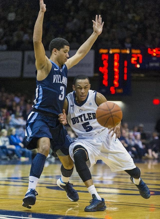 Butler's Elijah Brown (5) looses control of the ball as he tries to beat Villanova's Josh Hart (3) to the basket in the first half of an NCAA college basketball game Tuesday, Dec. 31, 2013, in Indianapolis. (AP Photo/Doug McSchooler)
