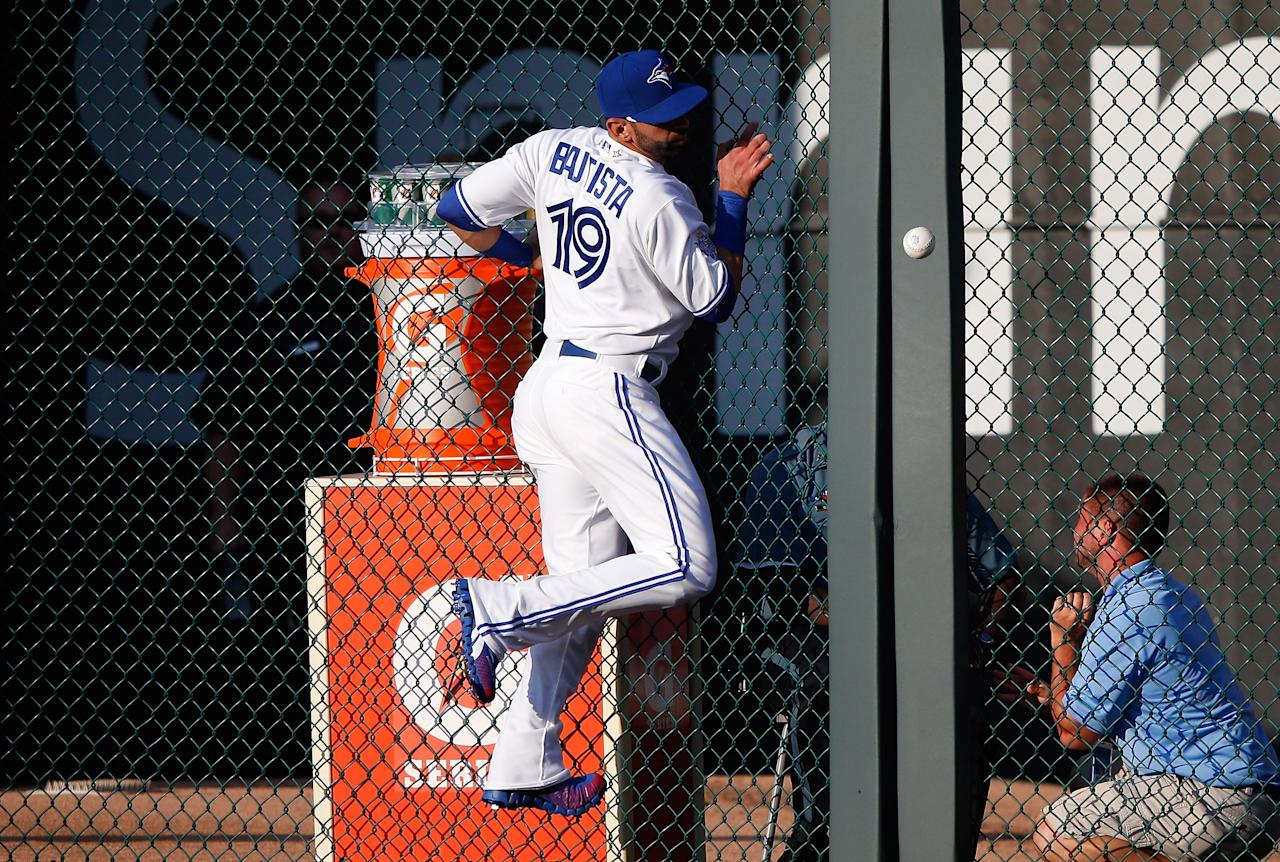 KANSAS CITY, MO - JULY 10:  American League All-Star Jose Bautista #19 of the Toronto Blue Jays is unable to come up with a ball hit by National League All-Star Pablo Sandoval #48 of the San Francisco Giants as Sandoval gets a three-run triple in the first inning during the 83rd MLB All-Star Game at Kauffman Stadium on July 10, 2012 in Kansas City, Missouri.  (Photo by Jamie Squire/Getty Images)