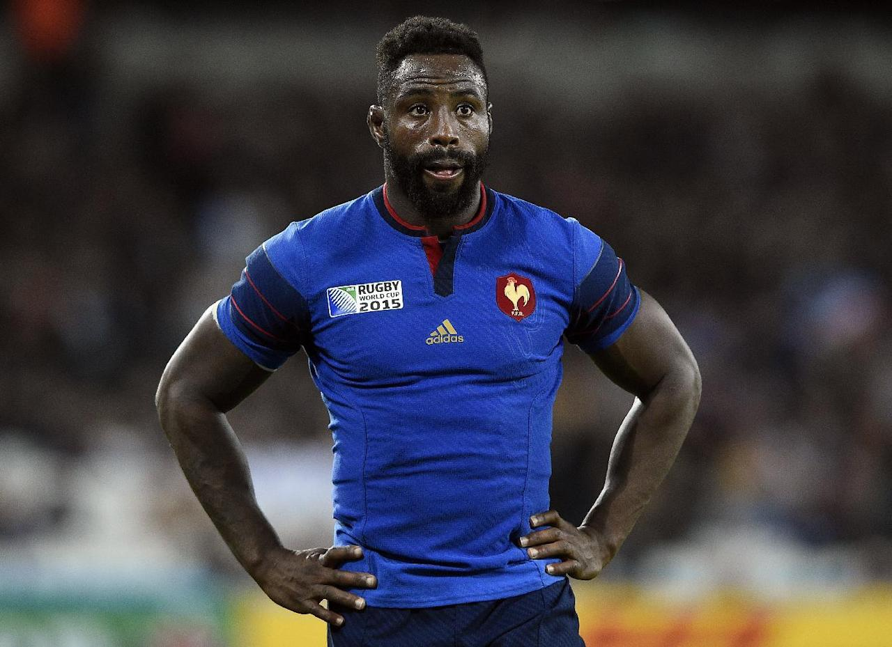 France's flanker Fulgence Ouedraogo reacts during a Pool D match of the 2015 Rugby World Cup between France and Romania at the Olympic stadium, east London, on September 23, 2015. AFP PHOTO / FRANCK FIFE RESTRICTED TO EDITORIAL USE, NO USE IN LIVE MATCH TRACKING SERVICES, TO BE USED AS NON-SEQUENTIAL STILLS (AFP Photo/FRANCK FIFE)