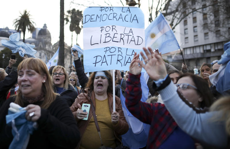 "A woman holds a sign reading in Spanish ""For democracy, for liberty, for country"" during march in support of President Mauricio Macri, in Buenos Aires, Argentina, Saturday, Aug. 24, 2019. Following a social media campaign large numbers of people gathered in the center of Buenos Aires to show their support for Macri's administration. (AP Photo/Natacha Pisarenko)"