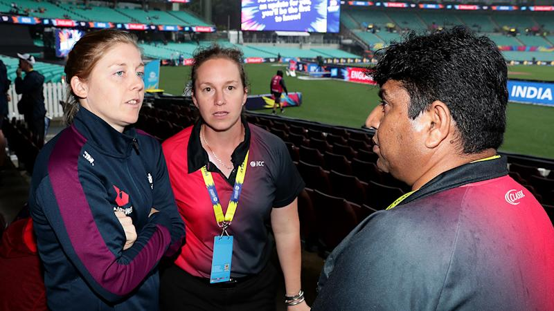 England captain Heather Knight, pictured here speaking to cricket officials at the SCG.