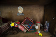 Unused school materials lay on a shelf at a school in the community of Nuevo Yibeljoj, Chiapas state, Mexico, Friday, Sept. 11, 2020. Amid the new coronavirus pandemic, Mexican education officials recently said that enrollment for the new school year was down about 10%, but teachers warn that many students enrolled out of habit, but aren't participating. (AP Photo/Eduardo Verdugo)