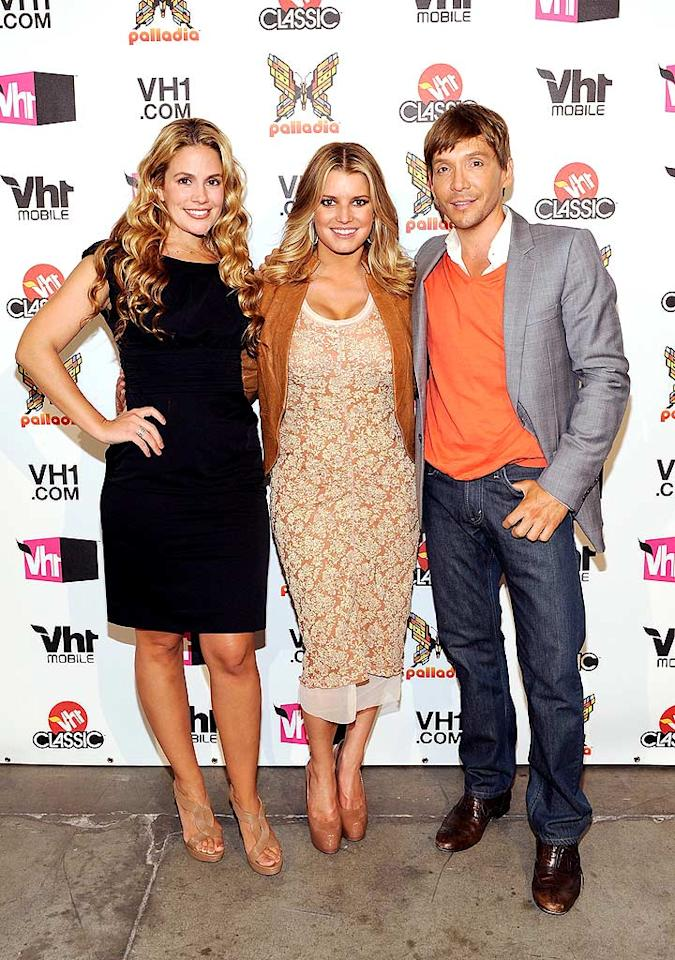 "Jessica Simpson, wearing yet another unflattering dress, had the support of her BFFs, CaCee Cobb and Ken Paves, at the VH1 Upfront presentations at Pier 59 Studios in New York City Tuesday night. Jess hit the stage at the event to promote her reality show ""The Price of Beauty."" Larry Busacca/<a href=""http://www.gettyimages.com/"" target=""new"">GettyImages.com</a> - April 20, 2010"