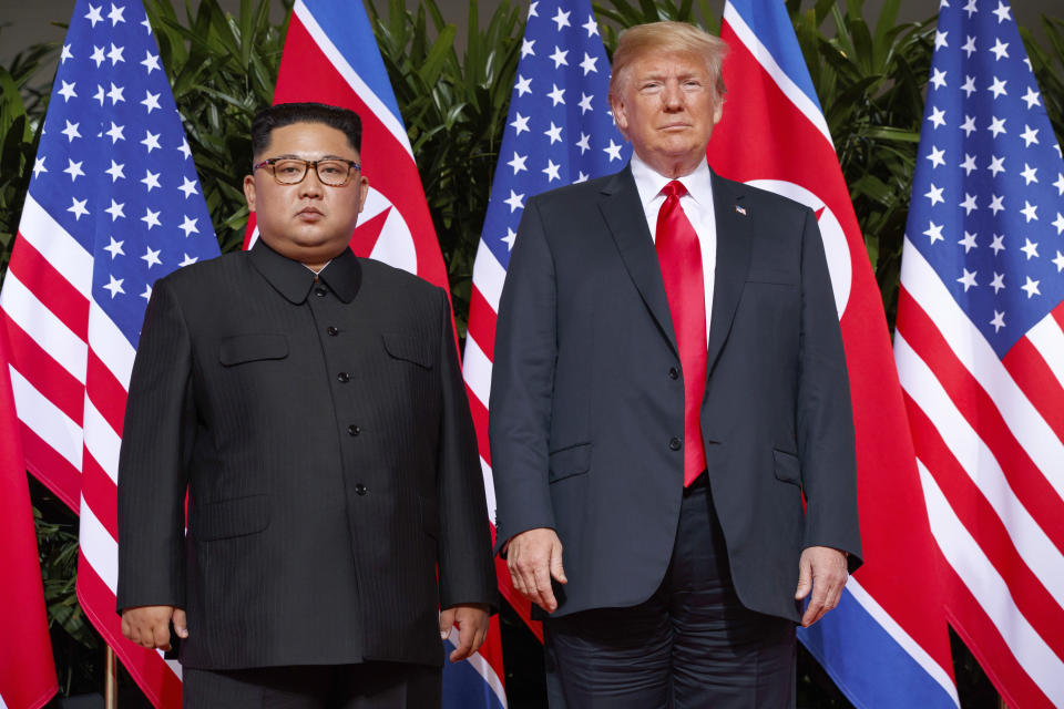 FILE - In this June 12, 2018, file photo, U.S. President Donald Trump, right, stands with North Korean leader Kim Jong Un on Sentosa Island in Singapore. North Korea and the United States are trying to revive stalled diplomacy meant to rid the North of its nuclear weapons. There was much talk of the possibility of success following a meeting in June between Trump and Kim, but in the months since there has been little to quiet skeptics who believe the North will never give up weapons it has described as necessary to counter a hostile Washington. (AP Photo/Evan Vucci, File)