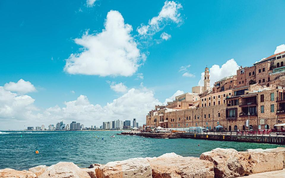 Old Jaffa and a distant view of modern Tel Aviv - getty