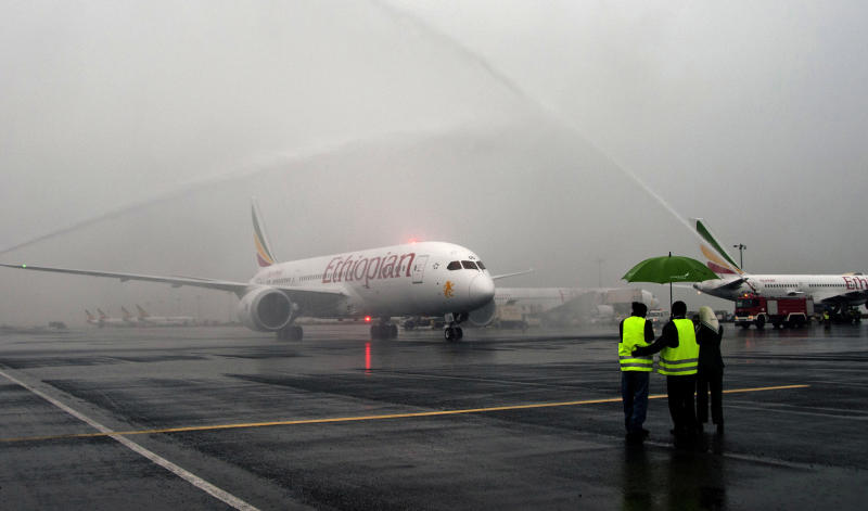FILE - In this Friday, Aug.17, 2012 file photo, an Ethiopian Airlines Dreamliner Boeing 787 taxis on the runway as fire engines spray arcs of water over the plane at Bole International airport in Addis Ababa, Ethiopia. A senior Ethiopian Airlines official said Thursday, Dec. 13, 2012 that a merger proposal made recently by the chief executive of Kenya Airways is not practical. (AP Photo/Elias Asmare, File)
