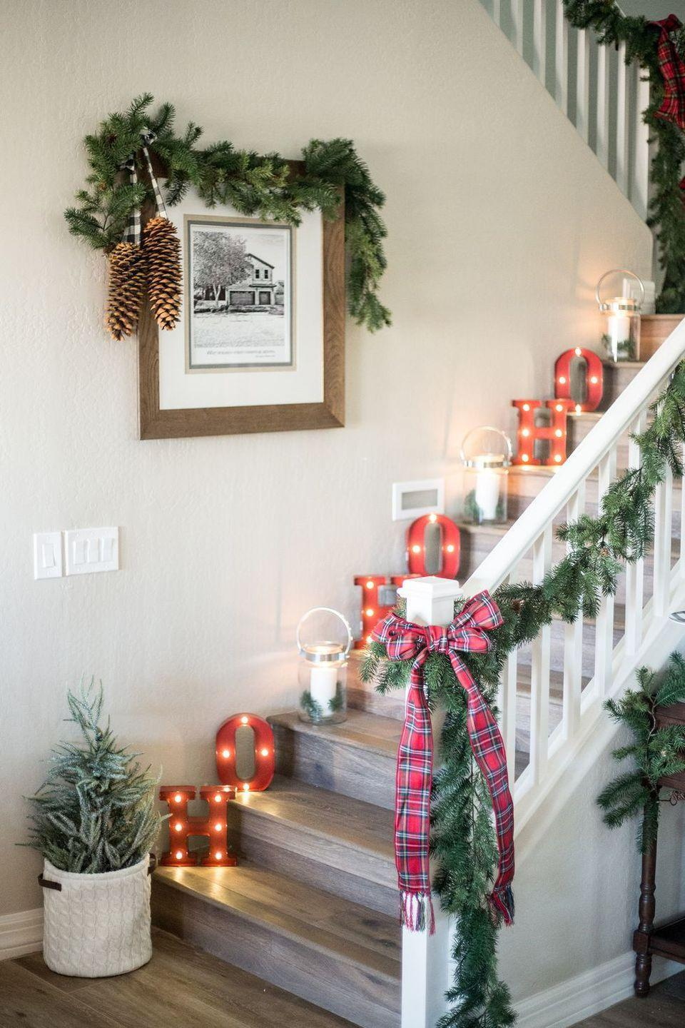 <p>Give your stairs some holiday theatrics with vintage-inspired marquee letters.</p>