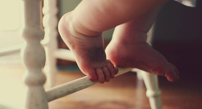 File photo of baby feet after a one-month-old died in China because its grandfather gave it a sip of alcohol.