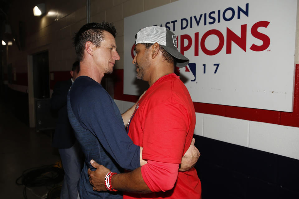 Milwaukee Brewers manager Craig Counsell, left, speaks with Washington Nationals manager Dave Martinez outside the Nationals clubhouse after a National League wild-card baseball game, Tuesday, Oct. 1, 2019, in Washington. Washington won 4-3. (AP Photo/Patrick Semansky)