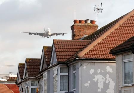 FILE PHOTO: A Singapore Airlines Airbus A380 passes over homes in Waye Avenue as it comes into land at Heathrow Airport, London