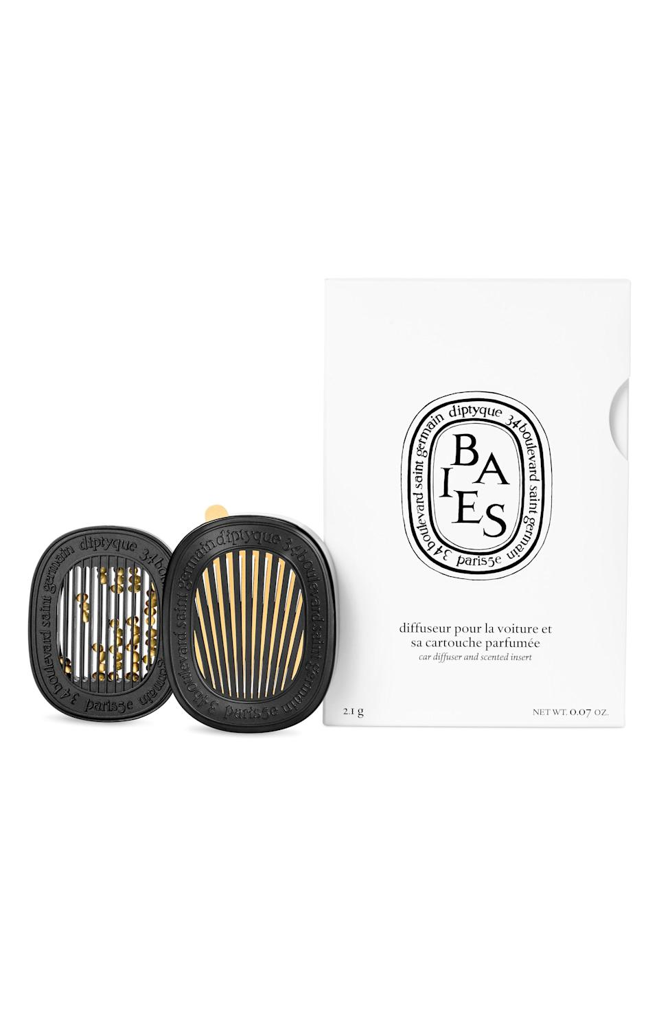 """<p><strong>Diptyque </strong></p><p>nordstrom.com</p><p><strong>$108.00</strong></p><p><a href=""""https://go.redirectingat.com?id=74968X1596630&url=https%3A%2F%2Fwww.nordstrom.com%2Fs%2Fdiptyque-baies-car-diffuser-insert%2F5385238&sref=https%3A%2F%2Fwww.oprahdaily.com%2Flife%2Fg36231053%2Fbest-essential-oil-diffusers%2F"""" rel=""""nofollow noopener"""" target=""""_blank"""" data-ylk=""""slk:SHOP NOW"""" class=""""link rapid-noclick-resp"""">SHOP NOW</a></p><p>For an ultra-luxe option to the nostalgic pine tree air freshener, affix this fruity-scented Diptique diffuser to your car's vent. </p>"""