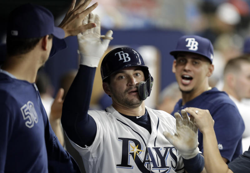 Tampa Bay Rays' Mike Zunino celebrates with the bench after his home run off Kansas City Royals pitcher Tim Hill during the sixth inning of a baseball game Tuesday, April 23, 2019, in St. Petersburg, Fla. (AP Photo/Chris O'Meara)