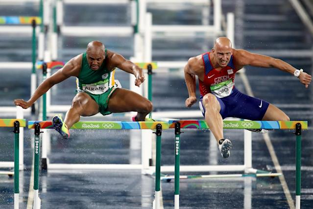<p>Antonio Alkana of South Africa (L) and Petr Svoboda of the Czech Republic compete during the Men's 110m Hurdles Round 1 – Heat 3. (Getty) </p>